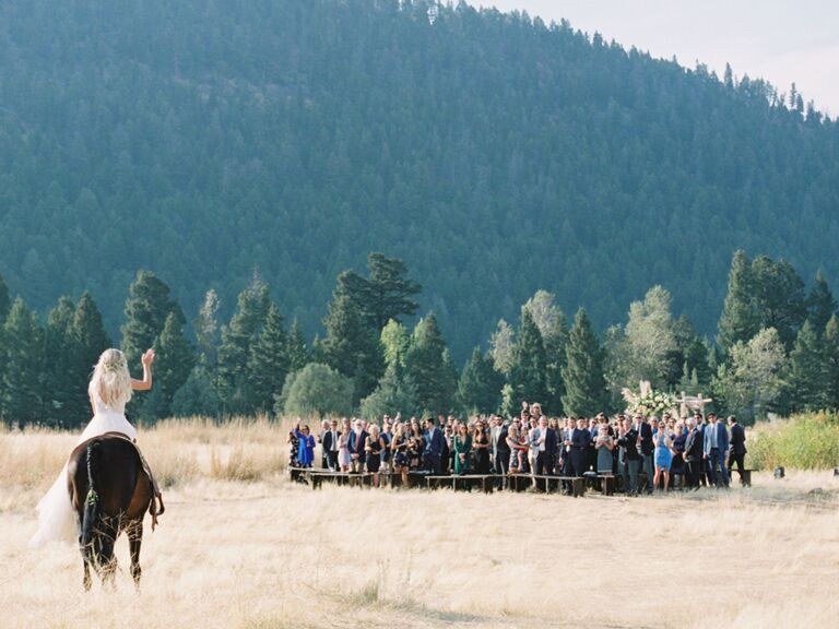 bride riding horse down aisle