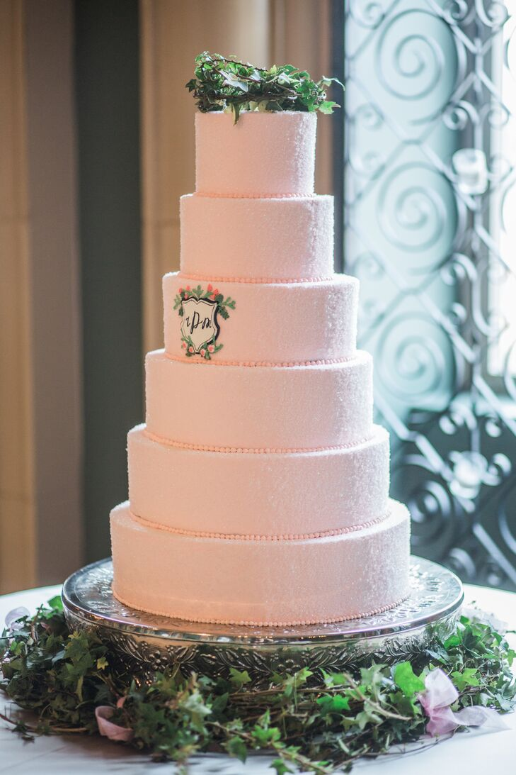 """The cake was buttercream cream cheese frosting with red velvet cake,"" Ivy says. ""I love red velvet and felt it would be fun to do something different from the traditional vanilla. Our custom crest was added to the central layer of the cake—a touch I truly appreciated. The topper was a nest of ivy. """