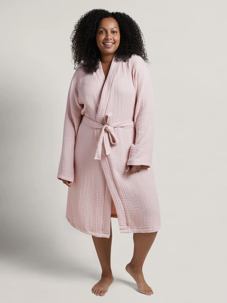 Woman wearing cozy pink bath robe