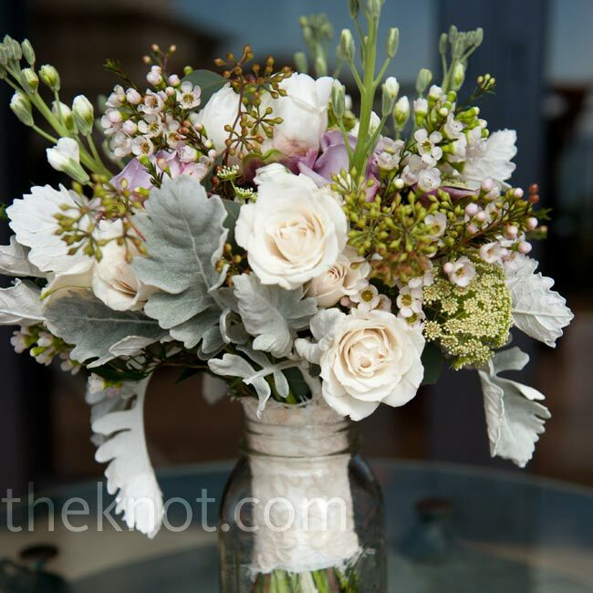 An ivory wrap with a lace overlay added a vintage touch to Jamie's Victorian-garden-inspired bouquet of stock, wax flowers, mini calla lilies, roses and seeded eucalyptus.