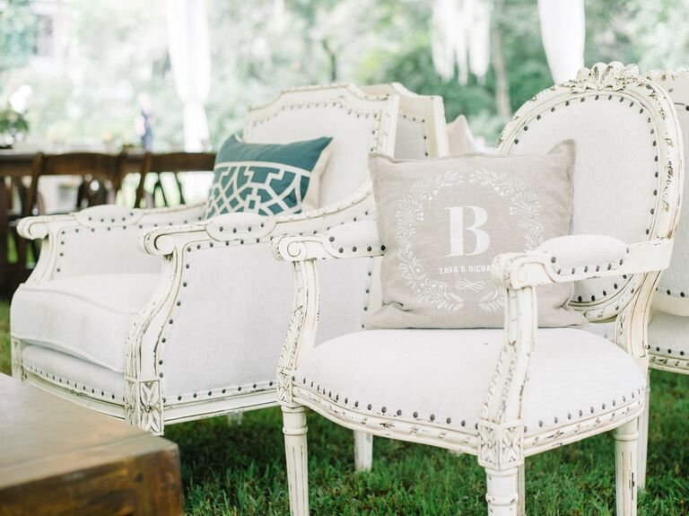 Outdoor wedding lounge furniture with monogrammed pillows - Wedding Rentals And Lighting Checklist