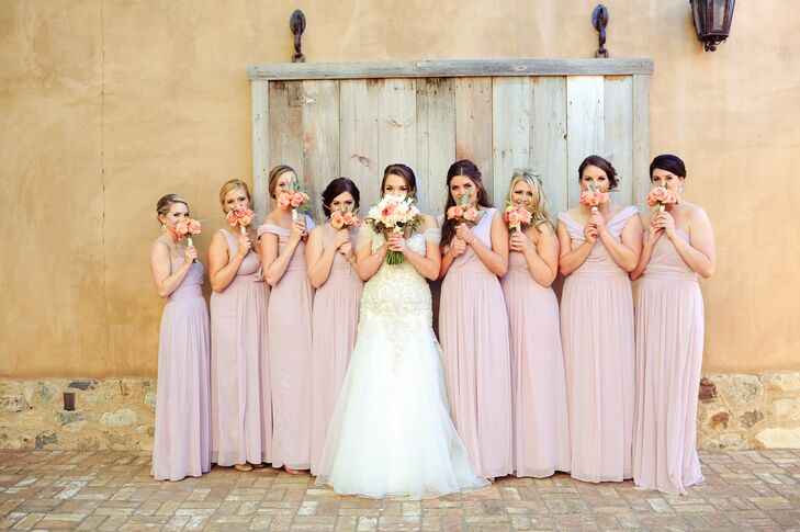 Nicole's bridesmaids chose their own floor-length chiffon dresses by Dessy in Suede Rose, which fit beautifully with the desert backdrop.