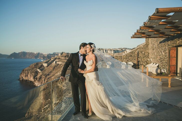 From Dubai, United Arab Emirates, Mariam and Bassel wanted a stylish, chic destination wedding complete with fireworks (literally) in Santorini, Greec