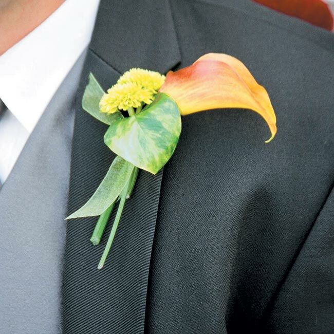 Scott complemented his gray vest and tie with a simple orange calla lily pinned to his lapel.