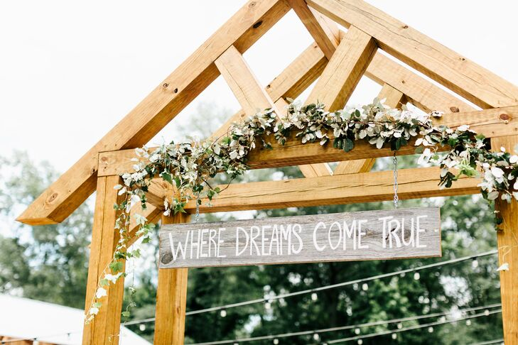 Wooden Arch With Garland and DIY Wooden Sign