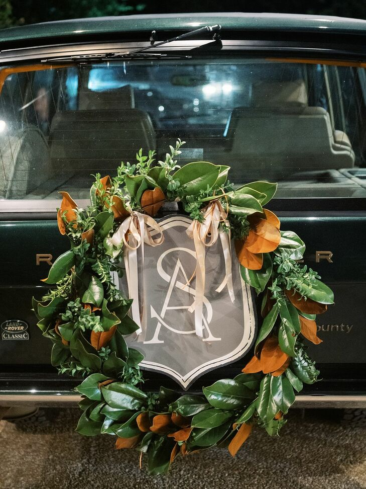 Monogrammed Wreath on Getaway Car at Rustic Estate Wedding in Ladue, Missouri