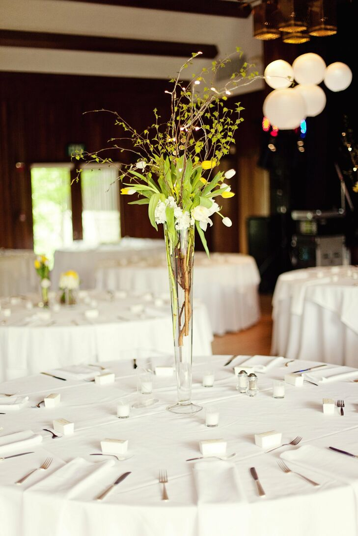 White and yellow tulip arrangements wowed in tall glass trumpet vases.