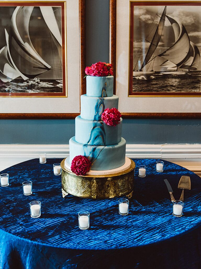Blue marbleized wedding cake with red peonies