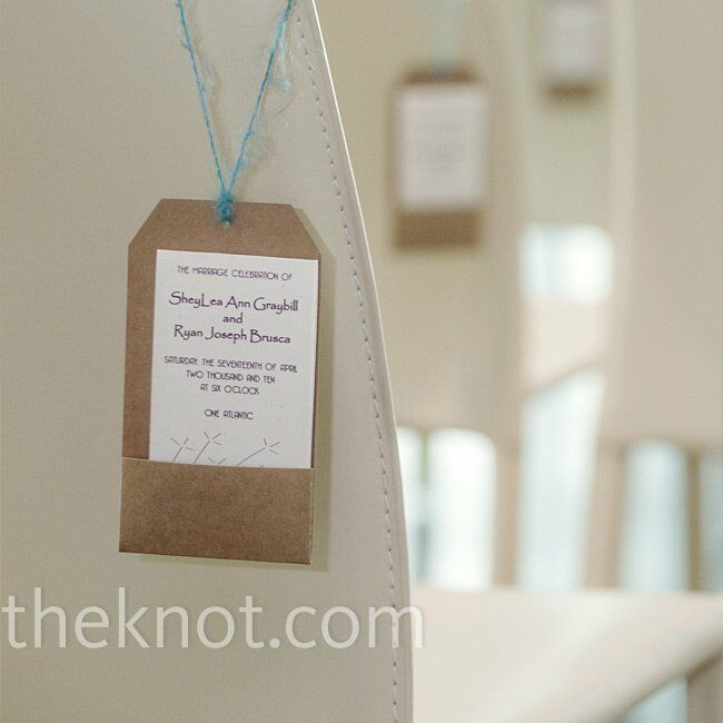 Brown tags with pockets holding cards explaining the ceremony's events hung from the chairs.