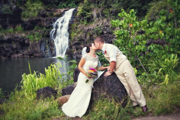 Bride and Groom Kiss at Waimea Valley Waterfall
