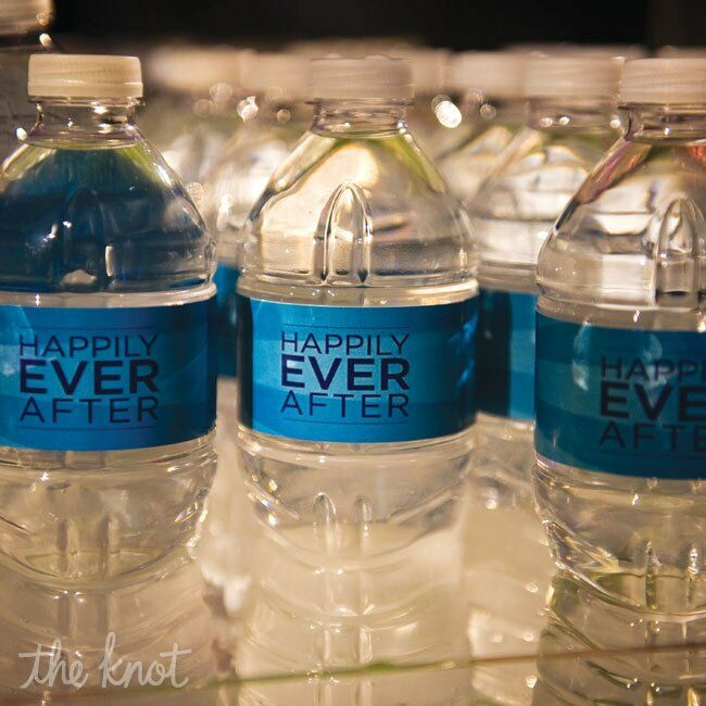 The couple  handed out water with personalized labels with superboy and supergirl on one side and happily every after on the other.
