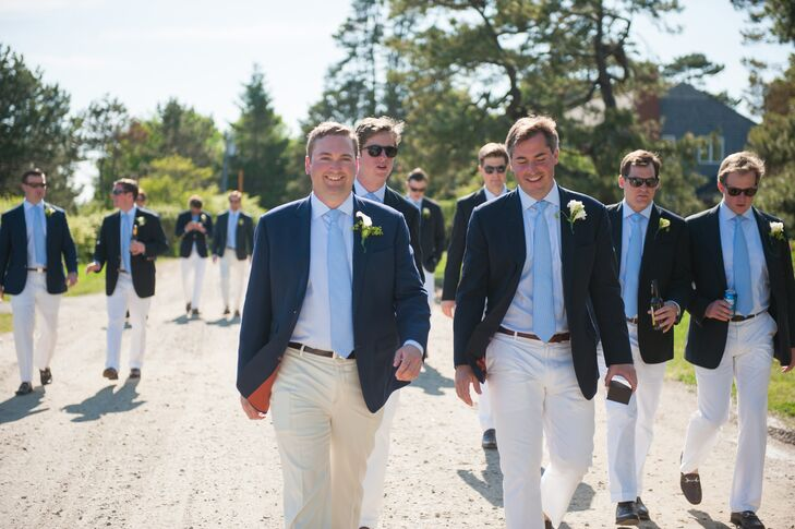 Brendan donned a navy blue suit coat, a light-blue shirt and tie, and khaki pants. Sarah gave him a Tiffany belt buckle with their wedding date inscribed in Roman numerals. Groomsmen wore similar ensembles but with white pants.