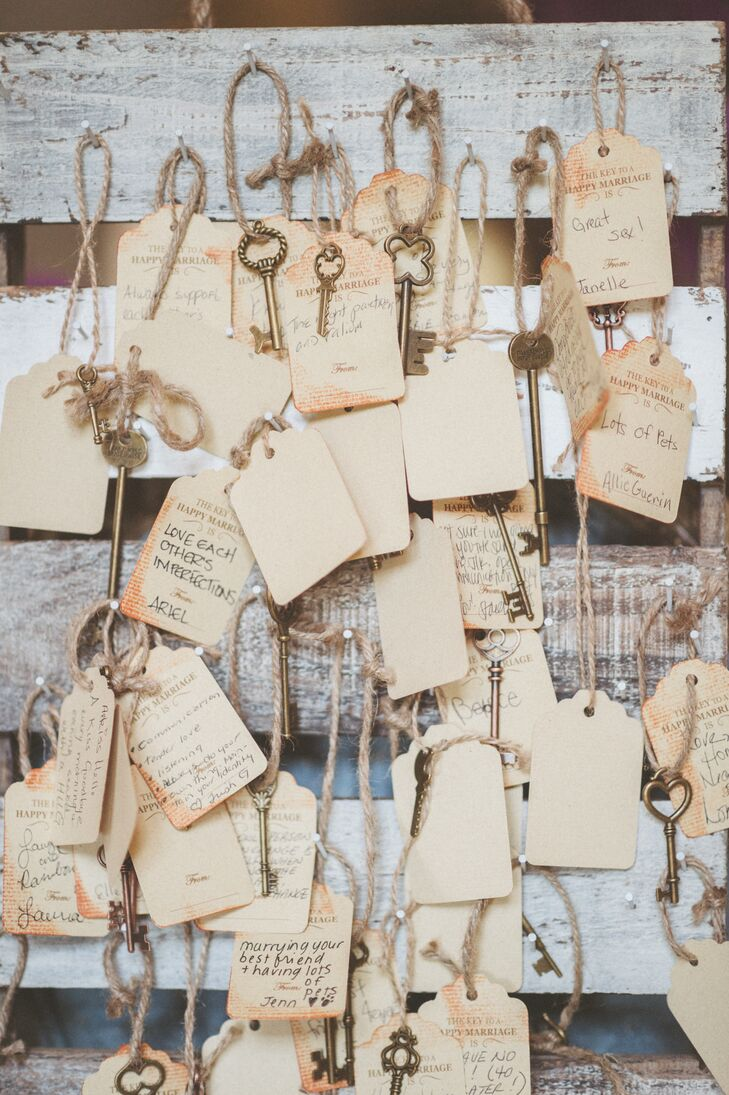 In lieu of a traditional guest book, Caroline and Michael invited their guests to share their tips for a happy marriage. Guests wrote their advice on antiqued gift tags trimmed with vintage keys and twine.