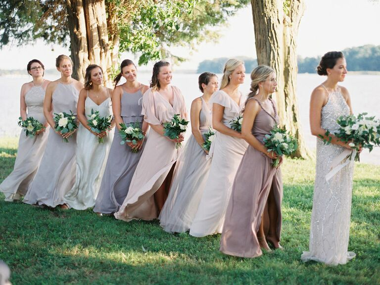 Bridesmaids watching vows during wedding ceremony
