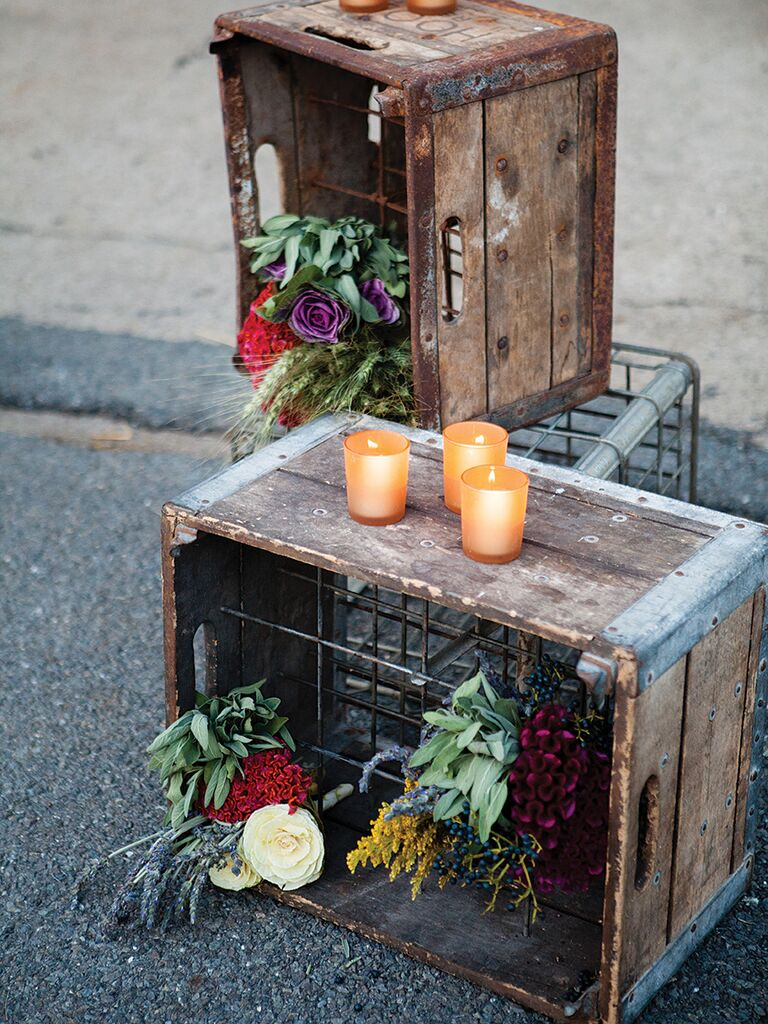 Romantic reception decor with wooden crates and tea lights
