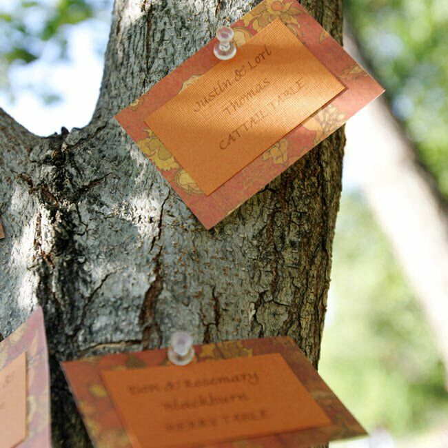 While the wedding party took photos in the nearby barn, Tatiana and Chris' guests found their reception seating assignments pinned to a tree.