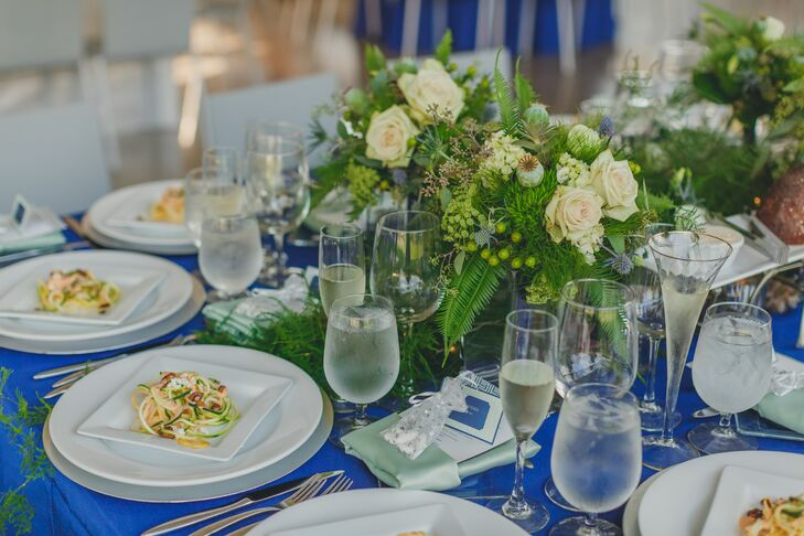 The color scheme was carried over into the reception space with bright blue tablecloths and mostly green centerpieces.