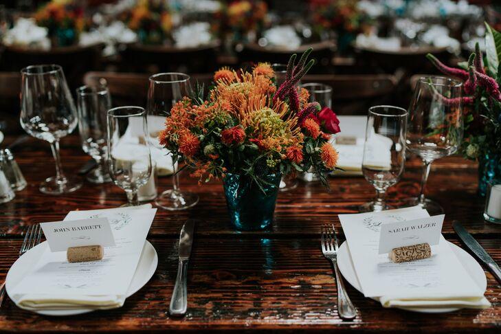 Orange Centerpieces and Wine Cork Escort Cards
