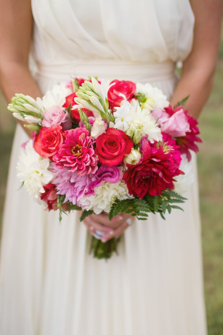 Amanda carried a bouquet of hot pink and white florals down the aisle at her wedding.