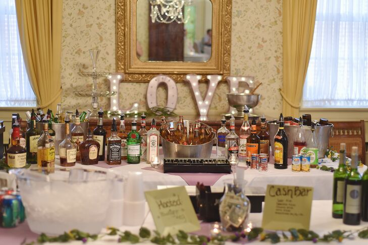 """The bar was decorated with an illuminated silver block-letter """"Love"""" sign."""