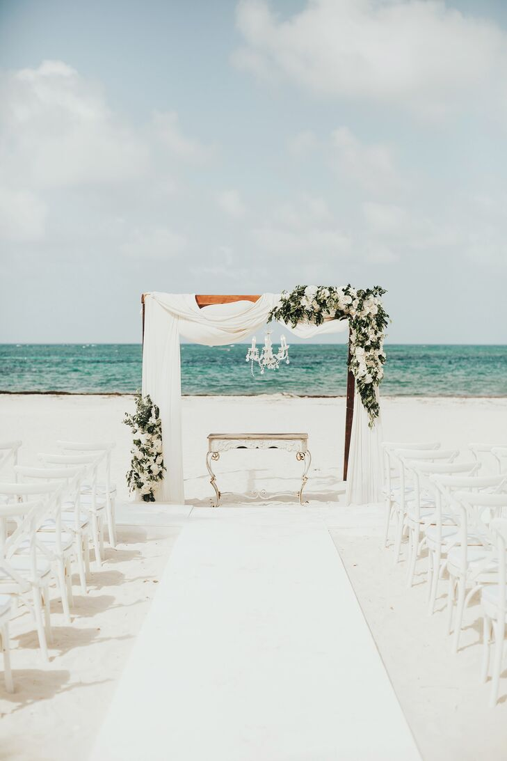 """My ceremony was a huge deal for me considering that is where the deal gets sealed,"" Angelica says. The couple's beach ceremony at Huracan Cafe in Punta Cana, Dominican Republic, was brought to life with rustic doors at the entrance of the aisle and a wooden arch draped in fabric and florals. ""There was live music playing as our guests arrived,"" Angelica says. ""I loved the sound of live music during the ceremony. It really sets the mood."""