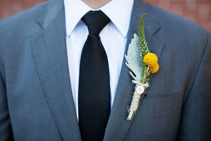 David added a pop of bright color to his cool gray suit with a boutonniere comprised of cheerful yellow craspedias, white veronica and dusty miller.