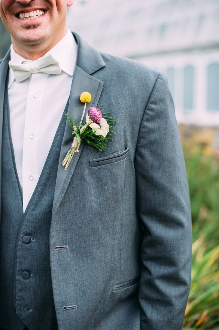 The groom wore a gray vest and tuxedo by M'Kaysha's Bridal Land with an ivory bow tie to match the bride. A wildflower boutonniere was pinned to his jacket.
