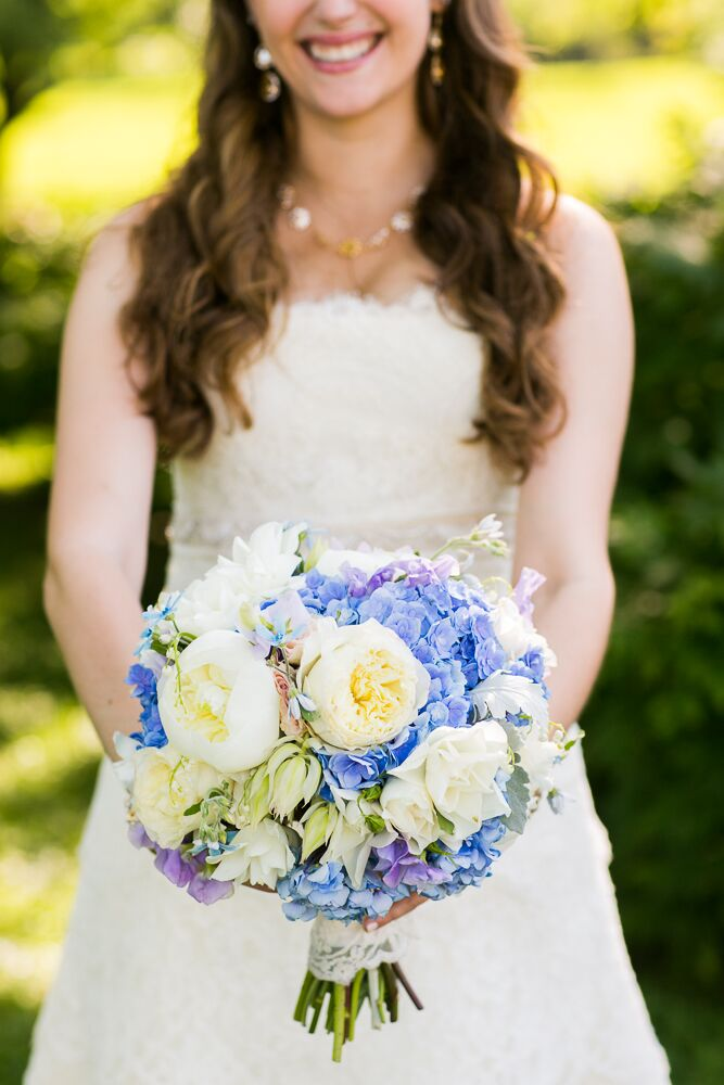 Alexandra carried a beautiful round bouquet, created by the wedding day florist, Rebecca Shepherd Floral Designs, of peonies, roses, irises and hydrangeas matching the vintage-inspired color palette of soft blue, purple and green.