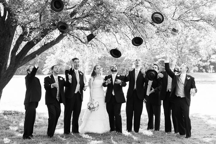"""""""My favorite part about the groomsmen's style was their hats,"""" Alexandra says, """"which we gave to them as thank-you gifts."""" Alexandra and Will bought each groomsman a black top hat from Goorin Brothers, adding a traditional, vintage touch to their formal black tuxedos."""