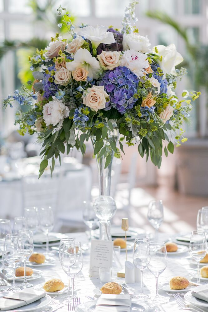 Alexandra and Will chose a color palette of soft blue, purple and green with pops of pink and light coral for their whimsical, vintage wedding. Their florist, Rebecca Shepherd Floral Designs, created the beautiful arrangements of roses, peonies, irises and hydrangeas keeping with these colors.