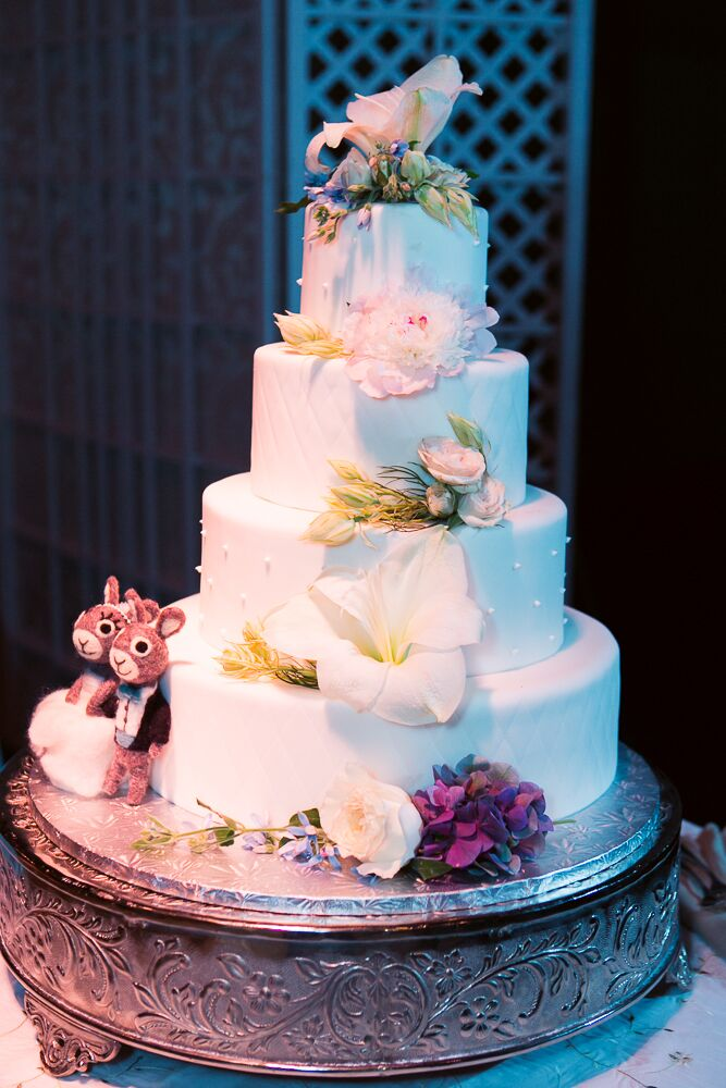 Four-Tier Round Wedding Cake With Fresh Flowers