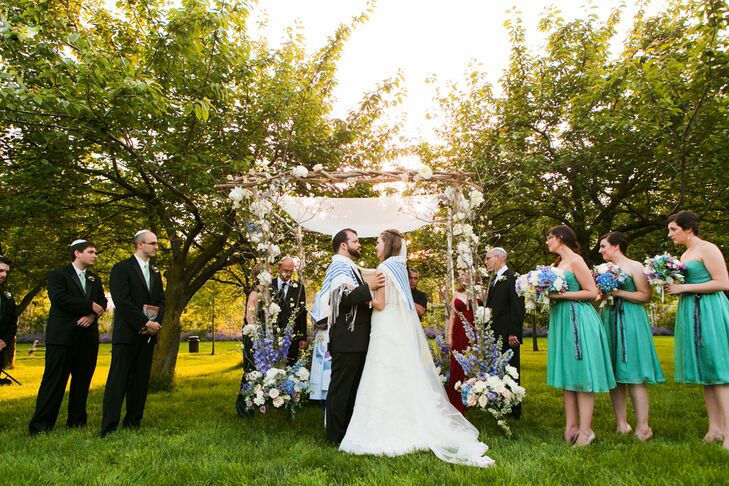 """Alexandra and Will really wanted to involve their families in their wedding day. """"Using my grandfather's tallit, or prayer shawl, and Will's grandfather's wedding band made the ceremony extra-special and kept our family close to our hearts during the whole thing,"""" Alexandra says."""