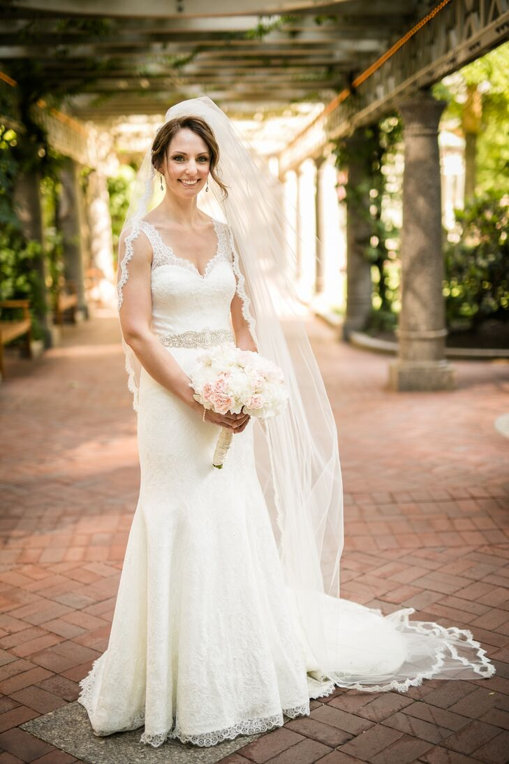 When Rebecca embarked on her mission to find the perfect dress for her classic, formal affair, she had several styles in mind, though they varied significantly. After trying on several gowns at Allegria Bridal in Belmont, Massachusetts, she finally came across one that truly caught her attention—a lace mermaid-style gown by Augusta Jones. To give the gown a touch of personal flair, she had a few alterations made, including the addition of buttons and a keyhole back.