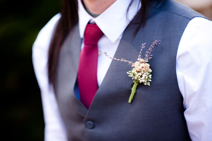 The men wore charcoal dress pants with vests, white button down shirts, and deep red ties that accented the bridesmaids' jewelry.