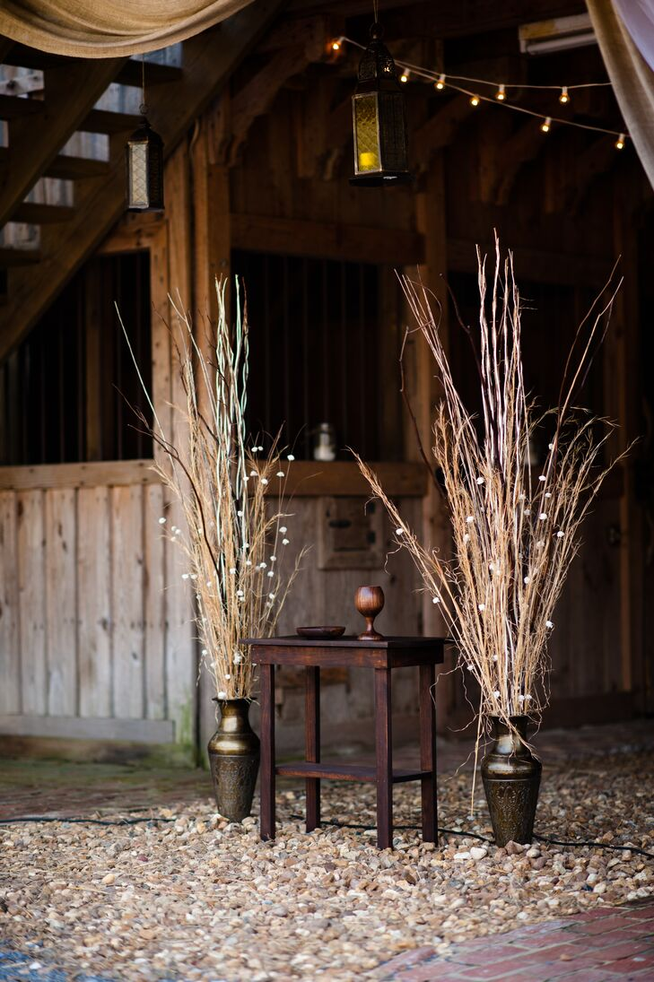 The couple decorated their rustic wedding similar to how they decorated their home: in neutral shades with rustic wood work and dried flowers.