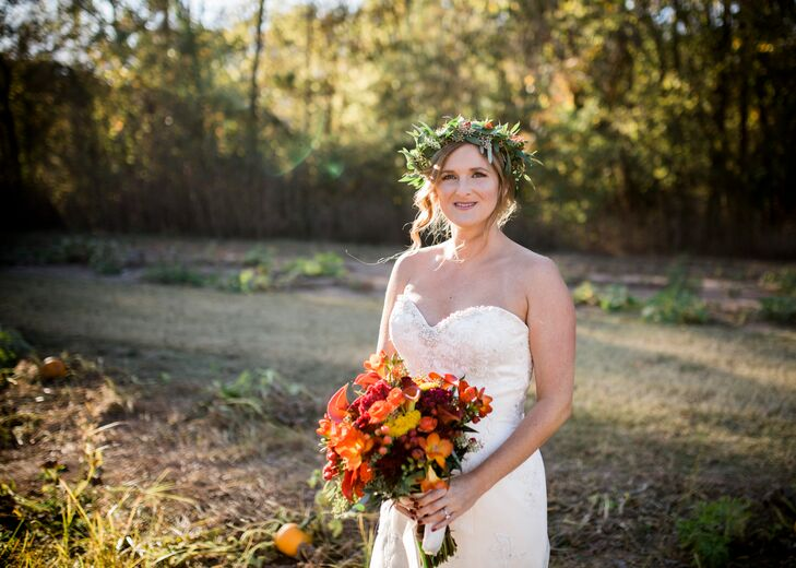 The color scheme was orange, maroon, red and gold in honor of the autumn season, offset by the deep blue and rich green of the wedding party.