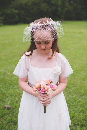 English-Inspired Flower Girl Attire with Pink Rose Bouquet
