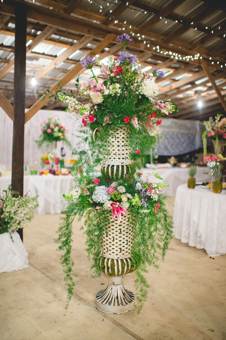 """I wanted a lot of variety in my floral designs,"" says the bride, whose mother, a floral designer, created all the arrangements. The arrangements were showcased in vintage vases, tea pots, mercury glass and miscellaneous vintage finds."