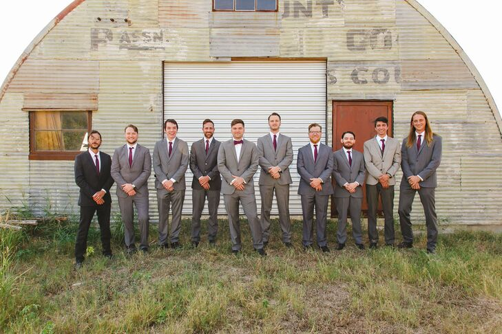 Anika's and Adam's male attendants wore gray suits, black shoes or boots and burgundy ties, playing into the wedding's rustic theme.