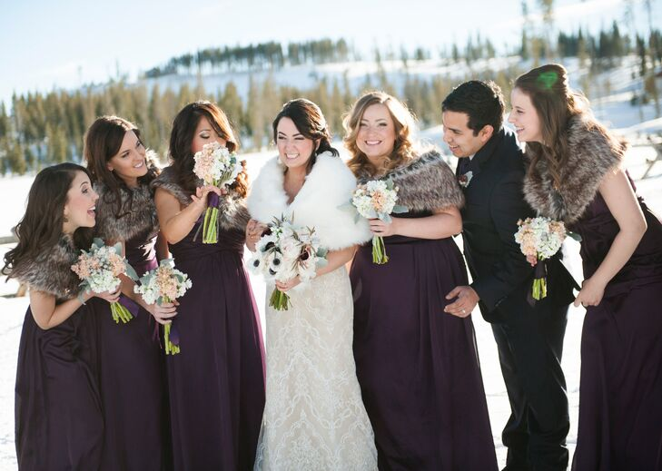 The bridesmaids wore floor-length plum dresses with faux fur stoles to match Kristen's white fur stole.