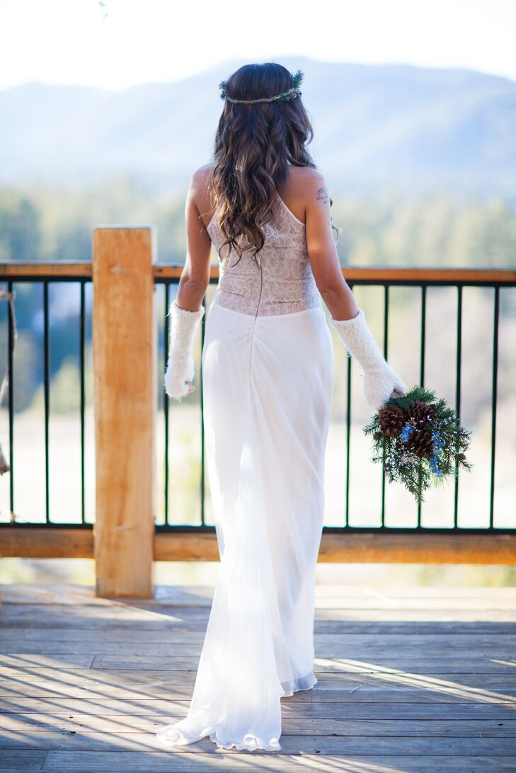 To go along with the winter season, Debora wore a pair of white fingerless gloves made of wool. This accessory blended well with her white BCBG wedding dress, accented with lace on the front and back of the bodice.