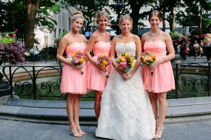 The three bridesmaids wore tulle dresses in coral from J.Crew with strappy nude sandals. As a gift, Krista gave each girl a crystal necklace and gold bracelets.