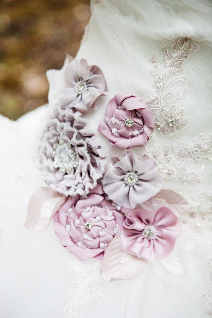 Satin and organza flowers in shades of purple with rhinestones, crystal beading and sequins provided the perfect touch for the bride's Alfred Angelo Sleeping Beauty dress.