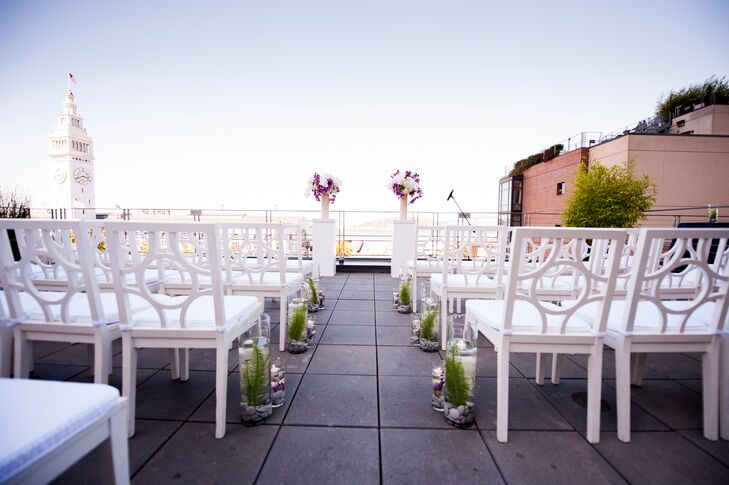 The ceremony took place on the terrace of Hotel Vitale, with the aisle simply decorated with small circular glass vases and two orchid arrangements at the front.