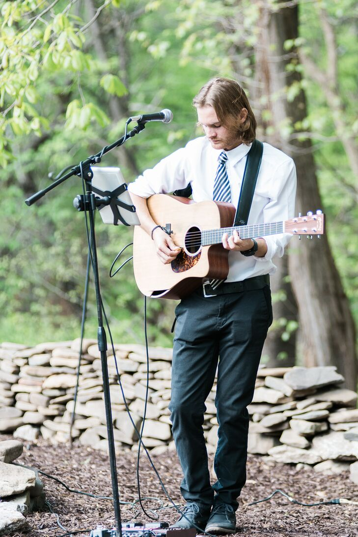 Jordan and Austin carefully chose all of the music for the ceremony and reception, to ensure that the right tone was set for each part of the day. For the ceremony and cocktail hour, Jordan asked her long-time friend Logan Ertel to perform. He played acoustic guitar and sang as guests arrived to the ceremony and as Jordan made her way down the aisle. During cocktail hour he played another acoustic set, incorporating tunes from artists like Ray LaMontagne, the Goo Goo Dolls and Katy Perry.