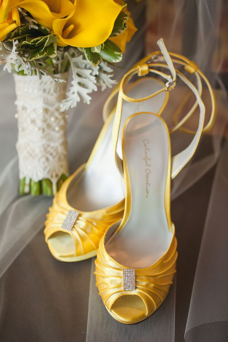 Jinitza added a pop of color to her white wedding dress with a pair of yellow heels, accented with crystals.