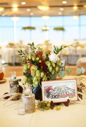Mountain-Themed Table Numbers and Centerpieces with Greenery, Candles and Wood