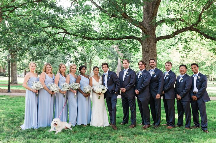 The bridesmaids wore cloudy blue dresses from Dessy. Each bridesmaid chose which style they wanted to wear. The groomsmen wore navy suits from Belk. The blue bow ties and pocket squares were made by Clay's mother.