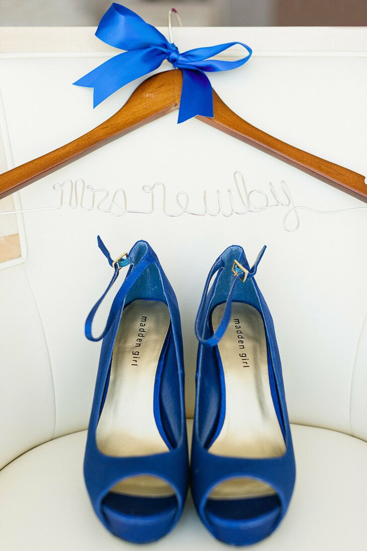 The bride wore these blue, peep-toe, satin pumps from Madden Girl down the aisle.