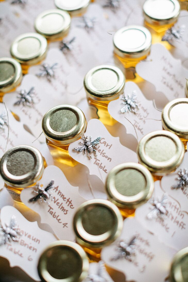 Escort cards were attached to small jars of honey, which also functioned as Lauren and Stephen's wedding favors. The honey is from Lauren's aunt and uncle's farm.